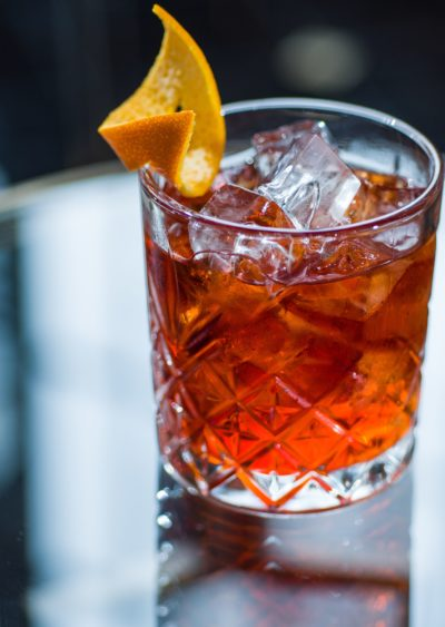 Drink in glass with orange peel