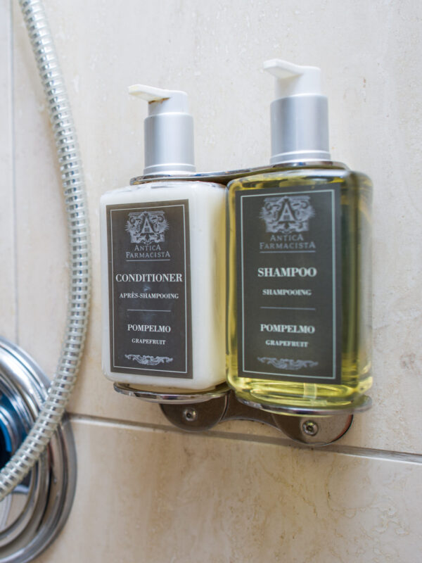 shampoo and conditioner bottles with pumps