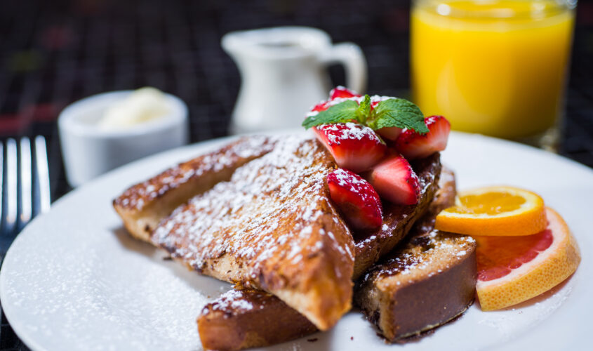 french toast with powdered sugar and strawberries