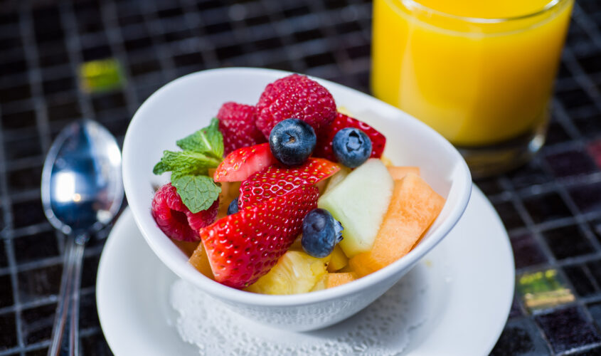 fruit cup with strawberries, blueberries, melon, raspberries, and pineapple