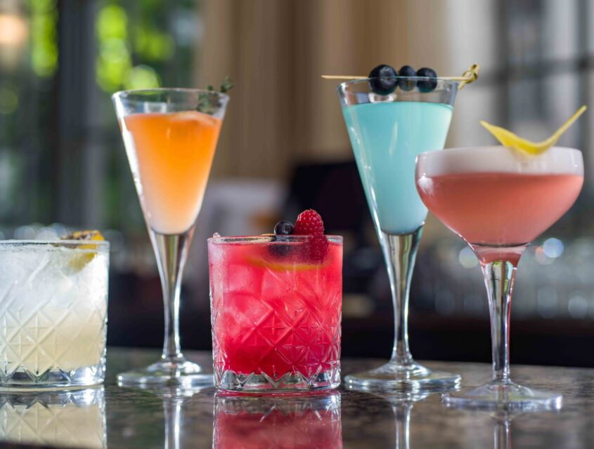 Five colorful craft cocktails at Oliver's Lounge in Seattle.