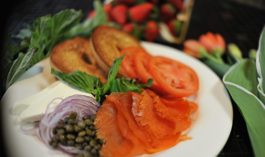 lox spread with bagels, tomato, salmon, capers, red onion, and cream cheese